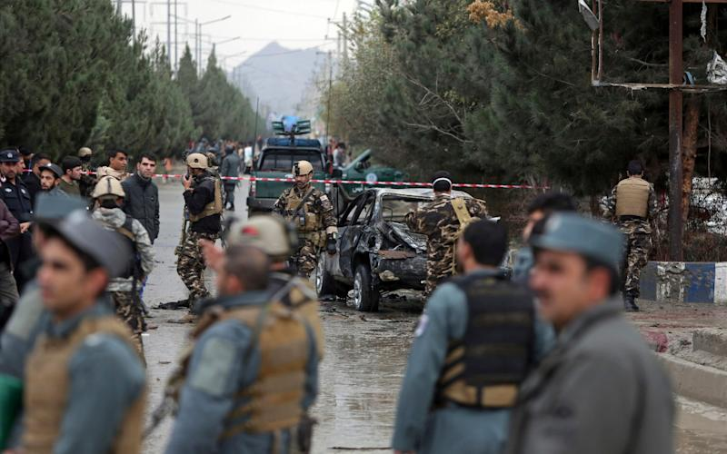 Afghan police officer Sayed Basam Pacha saved lives when he confronted a suicide bomber in Kabul - AP