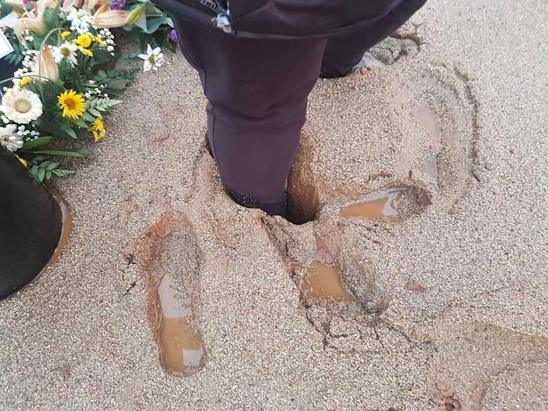 Ms Marshall had to be pulled out of the sinking sand (Picture: Michelle Marshall/Facebook)