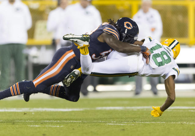<p>Chicago Bears linebacker Danny Trevathan (59) tackles Green Bay Packers wide receiver Randall Cobb (18) during the first quarter at Lambeau Field. Mandatory Credit: Jeff Hanisch-USA TODAY Sports </p>