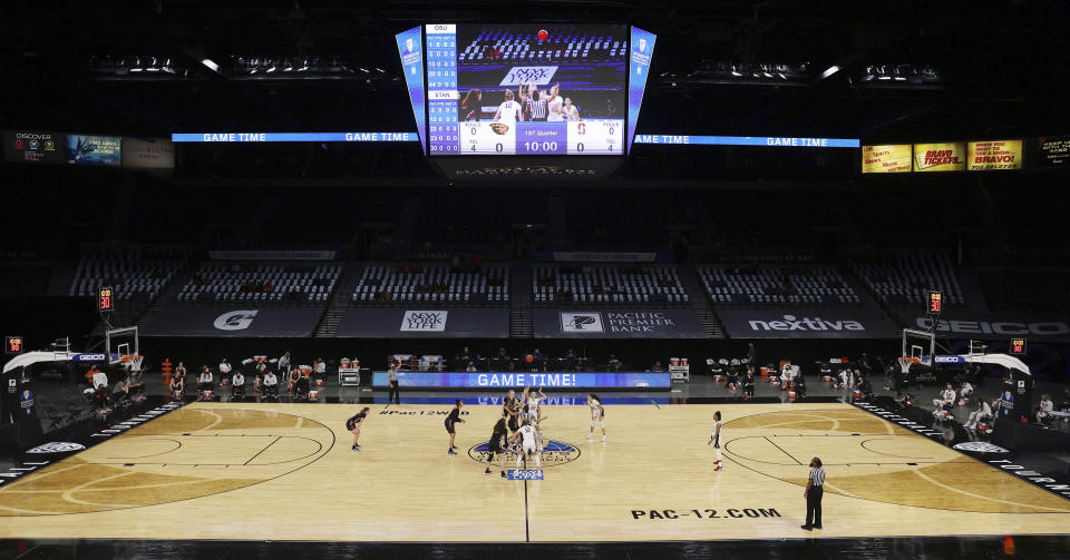 Oregon State and Stanford tip off to begin the first half of an NCAA college basketball game in the semifinal round of the Pac-12 women's tournament Friday, March 5, 2021, in Las Vegas. (AP Photo/Isaac Brekken)