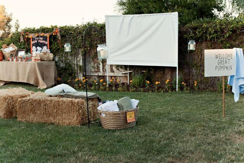 """<p>Invite friends over for a backyard <a href=""""https://www.oprahmag.com/entertainment/tv-movies/g27968094/best-halloween-movies-on-netflix/"""" rel=""""nofollow noopener"""" target=""""_blank"""" data-ylk=""""slk:horror movie night"""" class=""""link rapid-noclick-resp"""">horror movie night</a> this Halloween! (You could also screen <em>It's The Great Pumpkin, Charlie Brown</em> for a more kid friendly event.) All you need to create your own outdoor theater experience is a blank wall or sheet and a portable projector (you'll hook it up to your laptop or another device). Set up comfy seating and DIY a creepy concession stand.</p><p><em>See more of this party at <a href=""""https://www.catchmyparty.com/parties/great-pumpkin-outdoor-movie-night"""" rel=""""nofollow noopener"""" target=""""_blank"""" data-ylk=""""slk:Catch My Party"""" class=""""link rapid-noclick-resp"""">Catch My Party</a>. </em></p><p><a class=""""link rapid-noclick-resp"""" href=""""https://www.amazon.com/MoonLa-Flower-Differing-Unique-Creative/dp/B07KXR63ZF/?tag=syn-yahoo-20&ascsubtag=%5Bartid%7C10072.g.28787574%5Bsrc%7Cyahoo-us"""" rel=""""nofollow noopener"""" target=""""_blank"""" data-ylk=""""slk:SHOP PORTABLE PROJECTORS"""">SHOP PORTABLE PROJECTORS</a></p>"""