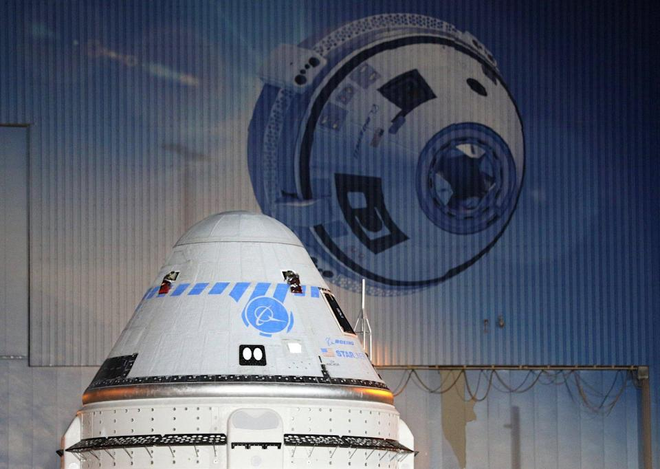 A close-up view of the CST-100 Starliner spacecraft while rolling out from Boeings Commercial Cargo and Processing Facility in the pre-dawn hours at the Kennedy Space Center in Cape Canaveral, Florida on July 17, 2021, ahead of its scheduled launch on July 30. (Photo by Gregg Newton / AFP) (Photo by GREGG NEWTON/AFP via Getty Images)