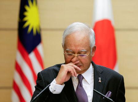 Malaysian Prime Minister Najib Razak attends a joint news conference with Japanese Prime Minister Shinzo Abe in Tokyo, Japan