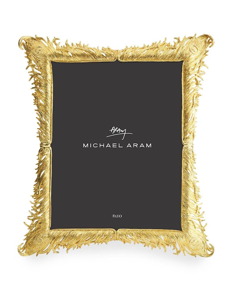 "<p><strong>Michael Aram</strong></p><p>https://www.neimanmarcus.com</p><p><strong>$175.00</strong></p><p><a href=""https://go.redirectingat.com?id=74968X1596630&url=https%3A%2F%2Fwww.neimanmarcus.com%2Fp%2Fmichael-aram-plume-gold-frame-8-x-10-prod235660121&sref=https%3A%2F%2Fwww.redbookmag.com%2Flife%2Fg34995902%2Fneiman-marcus-gift-guide%2F"" rel=""nofollow noopener"" target=""_blank"" data-ylk=""slk:Shop Now"" class=""link rapid-noclick-resp"">Shop Now</a></p>"