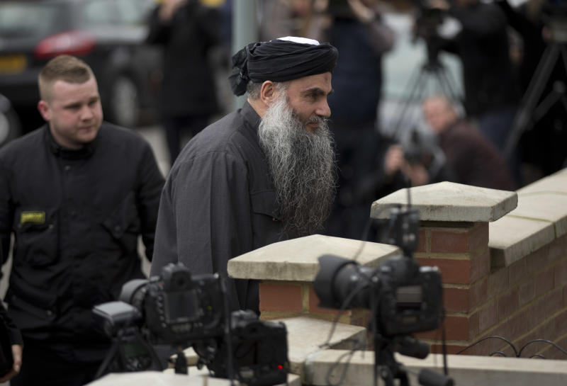 Abu Qatada, right, returns to his residence in London after being freed from prison, Tuesday, Nov. 13, 2012. The radical Islamist cleric described by prosecutors as a key al-Qaida operative in Europe cannot be deported from Britain to Jordan to face terrorism charges, judges ruled Monday in the latest twist in a protracted legal saga. (AP Photo/Matt Dunham)