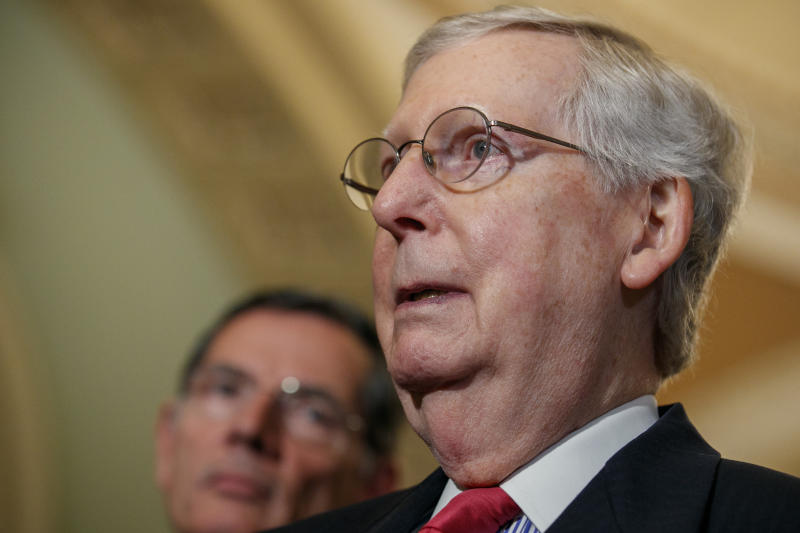 """Senate Majority Leader Mitch McConnell of Ky., right, next to Sen. John Barrasso, R-Wyo., speaks to the media after a weekly policy luncheon, Tuesday, July 16, 2019, in Washington. """"Everybody ought to tone down their rhetoric,"""" said McConnell. (AP Photo/Jacquelyn Martin)"""