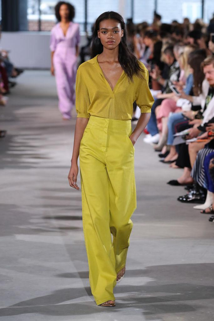 <p>Models over at Tibi dressed in mustard hues instead. It's a new take on colour-blocking. <em>[Photo: Getty]</em> </p>