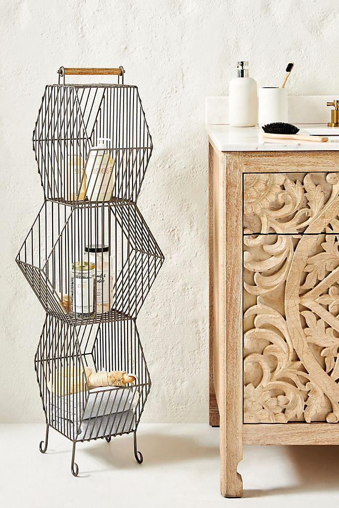 "<p>When you don't have much floor space, smart organizers think vertically. Hexagon-shaped metal baskets stack in several different ways, allowing you to find a perfect fit between other pieces of furniture or as a statement piece on their own, and offer just the right amount of space for extra towels, favorite novels, or your prettiest sweaters.</p> <p><strong><em>Shop Now:</em></strong><em> Anthropologie ""Clancy"" Basket Tower, $258, <a href=""https://click.linksynergy.com/deeplink?id=93xLBvPhAeE&mid=39789&murl=https%3A%2F%2Fwww.anthropologie.com%2Fshop%2Fclancy-basket-tower2%3Fcolor%3D007%26amp%3Btype%3DSTANDARD%26amp%3Bsize%3DOne%2BSize%26amp%3Bquantity%3D1&u1=MSL21DormRoomStorageIdeasThatMaketheMostofYourSmallSpacesbamseyStoGal7846410202007I"" rel=""nofollow noopener"" target=""_blank"" data-ylk=""slk:anthropologie.com"" class=""link rapid-noclick-resp"">anthropologie.com</a>.</em></p>"