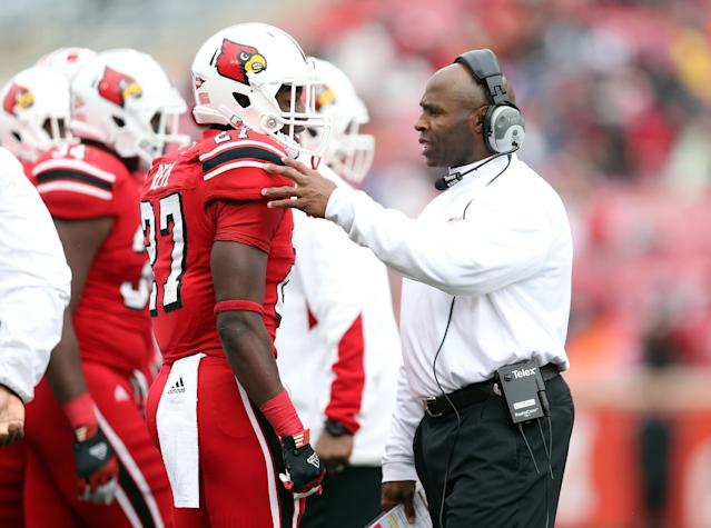 LOUISVILLE, KY - NOVEMBER 03: Charlie Strong the head coach of the Louisville Cardinals talks with Jermaine Reve #27 during the game against the Temple Owls at Papa John's Cardinal Stadium on November 3, 2012 in Louisville, Kentucky. (Photo by Andy Lyons/Getty Images)