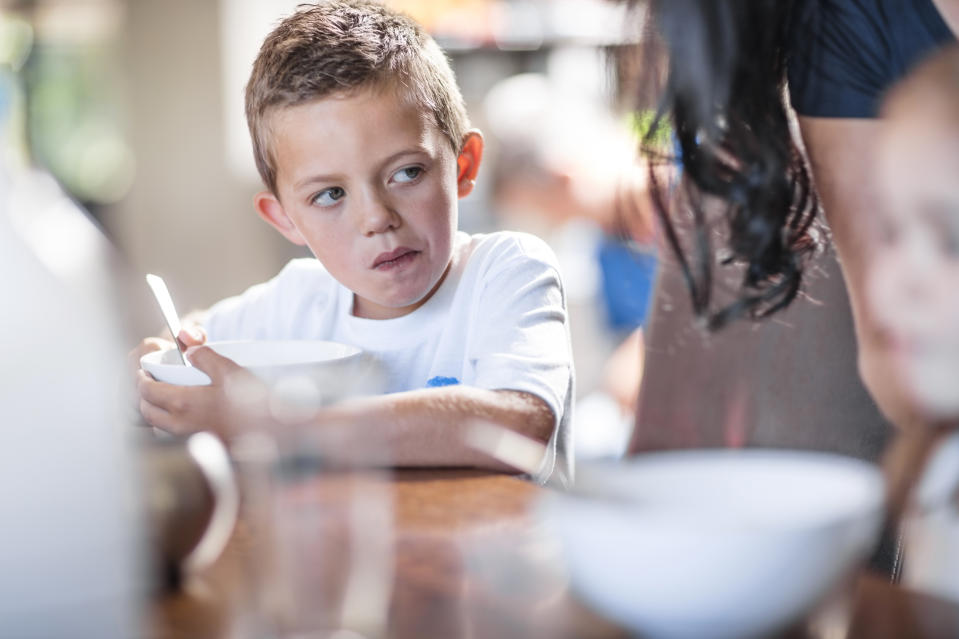 Boy eating curry sparks dad's anger