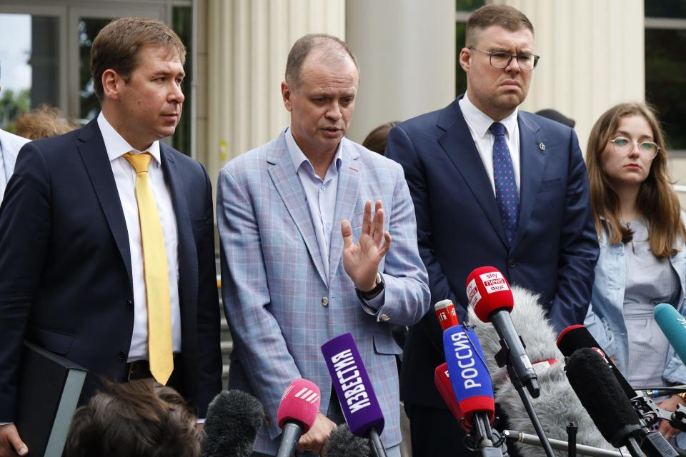 Russian lawyer Ivan Pavlov, center, gestures while speaking to the media as other lawyers stand around him during a break in a court session in front of Moscow Court, in Moscow, Russia, Wednesday, June 9, 2021. A court is expected to outlaw the organizations founded by Russian opposition leader Alexei Navalny. Prosecutors have asked the Moscow City Court to designate Navalny's Foundation for Fighting Corruption and his sprawling network of regional offices as extremist organizations. The extremism label also carries lengthy prison terms for activists who have worked with the organizations, anyone who donated to them, and even those who simply shared the groups' materials. (AP Photo/Alexander Zemlianichenko)
