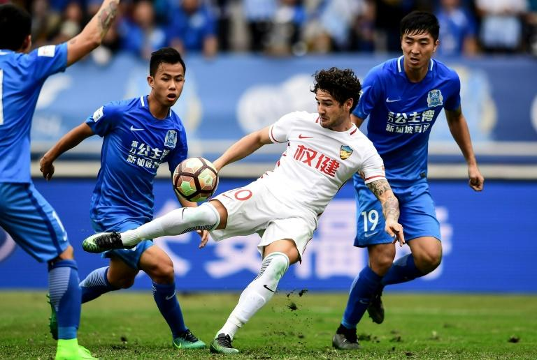 Striker Alexandre Pato (C) has re-discovered his love for football since signing for Tianjin Quanjian a year ago, sparking suggestions of a return to the Brazil team