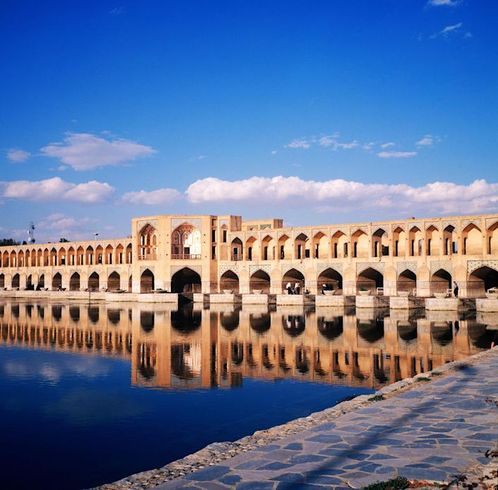 Built in 1650, Isfahan's Khaju Bridge was built at the height of the Safavid dynasty (1501–1736) in modern day Iran. The structure, which is 436 feet long and 40 feet wide, contains 23 arches. Beautiful in the daylight and at night, the Khaju Bridge is a popular public meeting spot.