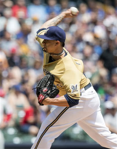 Milwaukee Brewers' Kyle Lohse throws to a Philadelphia Phillies batter during the first inning of a baseball game Sunday, June 9, 2013, in Milwaukee. (AP Photo/Tom Lynn)