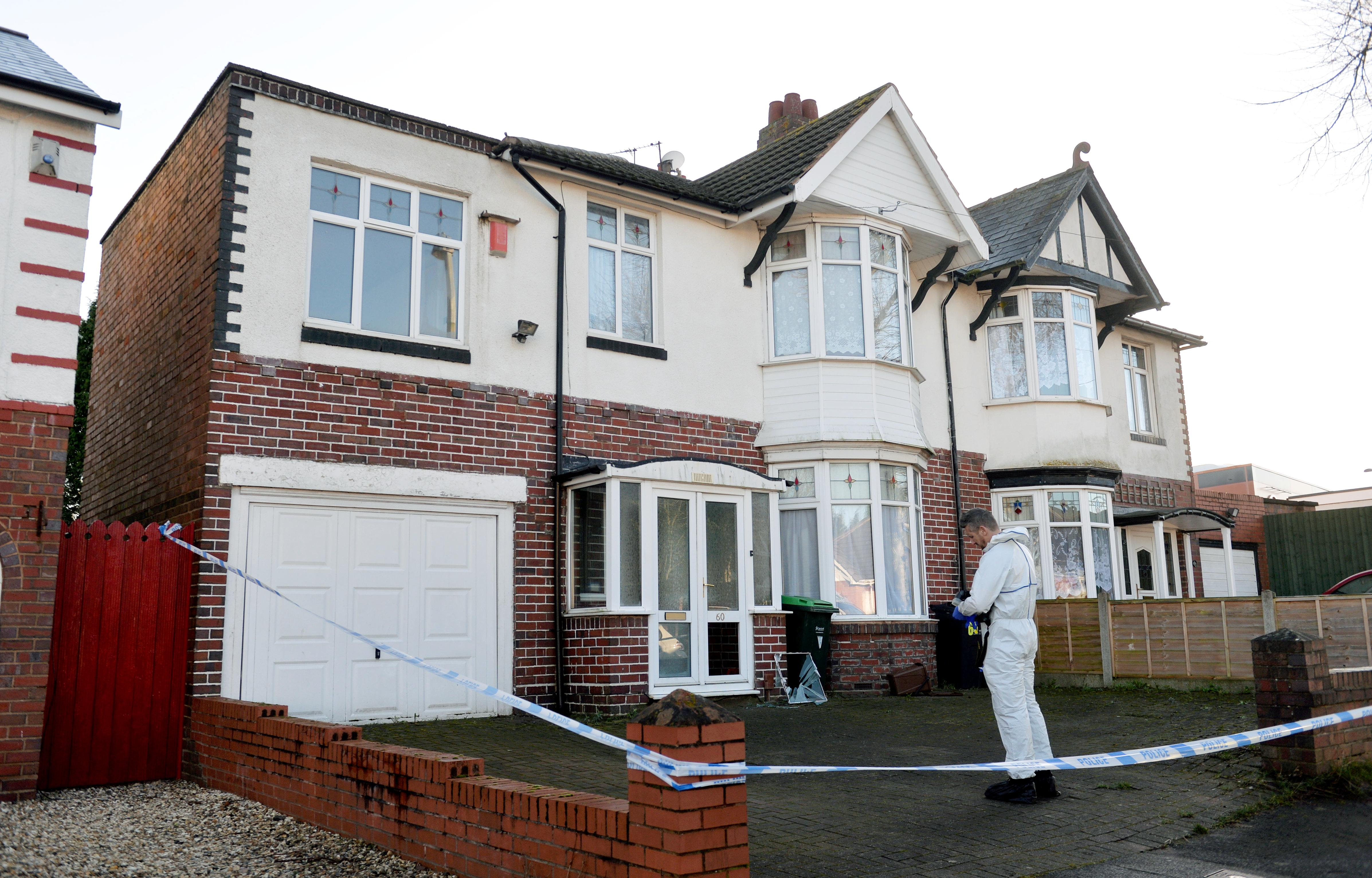 """Police at the scene in Moat Road in Oldbury, West Mids, where the bodies of a middle-aged couple were found in their home this morning. February 25, 2020. See SWNS story SWMDmurders. A 25-year-old man was arrested on suspicion of double murder today (Tues) after the bodies of a middle-aged couple were found in their home. Police officers forced their way into a house in Moat Road in Oldbury, West Mids., at 4am after receiving calls regarding the welfare of the couple. Inside the property officers found the bodies of a woman, 54, and a 52-year-old man who were pronounced dead at the scene. At 5.30am detectives arrested a 25-year-old man at an address in nearby Smethwick. Police are not confirming if the man was the victims' parents but say they are treating the murders as a """"domestic-related incident"""". A West Midlands Police spokesperson said: """"We've arrested a man on suspicion of murder after the bodies of two people were found in Oldbury today."""