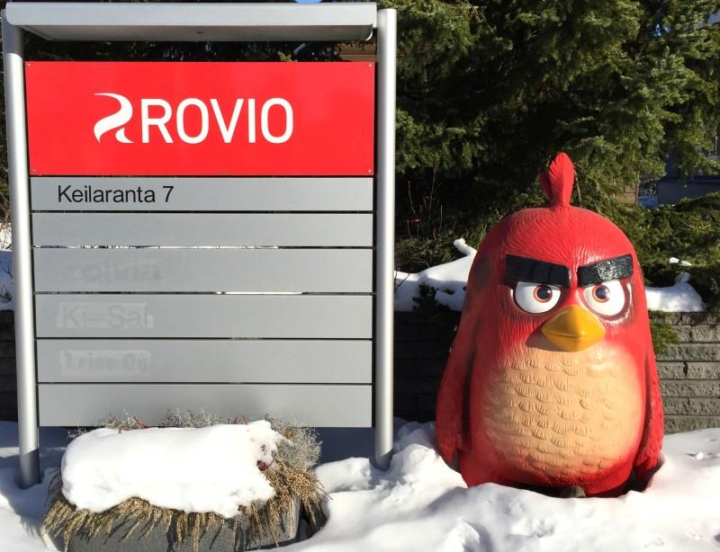 A Rovio sign and a figure of an Angry Birds character are seen in front of Rovio's headquarters in Espoo