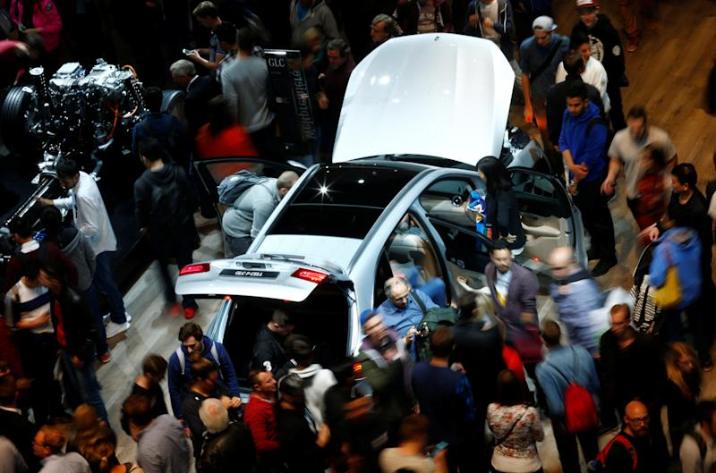 People walk around a Mercedes GLC F-Cell at the stand of German car manufacturer Mercedes at the Frankfurt Motor Show (IAA) in Frankfurt, Germany September 16, 2017. REUTERS/Ralph Orlowski