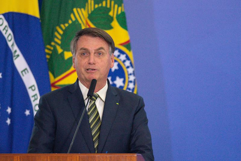 BRASILIA, BRAZIL - APRIL 29: President of Brazil Jair Bolsonaro speaks during the sworn in ceremony for newly appointed Justice Minister André Luiz Mendonça and new brazilian Attorney General Jose Levi Mello amidst on the coronavirus (COVID-19) pandemic at the Planalto Palace on April, 29, 2020 in Brasilia. Brazil has over 71,000 confirmed positive cases of Coronavirus and has over 5,000 deaths. (Photo by Andressa Anholete/Getty Images)