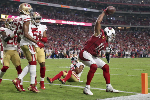 Larry Fitzgerald spiked the ball after a successful two-point conversion in the fourth quarter Sunday. (AP)