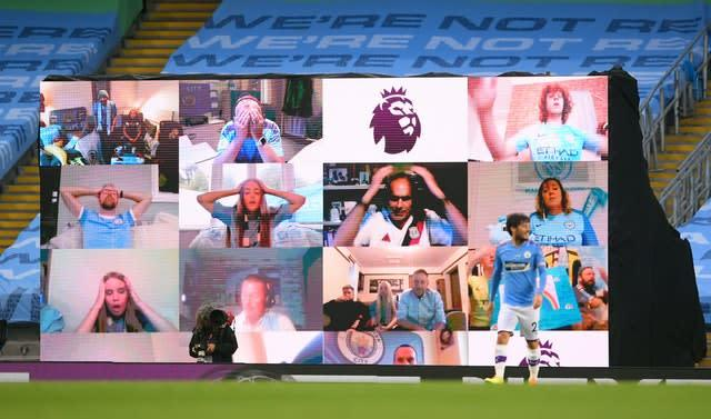 Manchester City fans reacted on the big screen (Laurence Griffiths/NMC Pool)