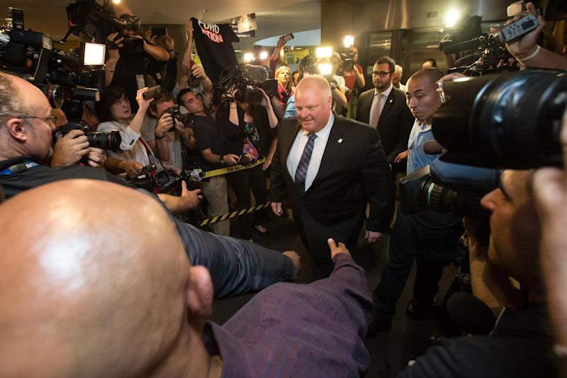 Toronto Mayor Rob Ford arrives at his office at city hall in Toronto on June 30, 2014 amid a crush of cameras