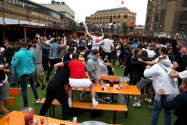 England fans celebrate at a beer garden in London