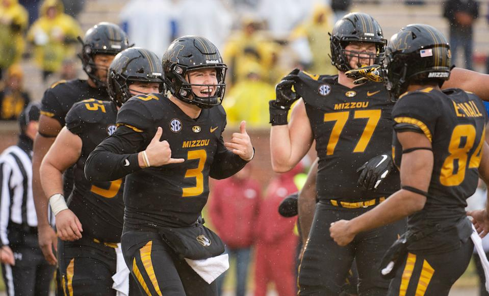 Missouri quarterback Drew Lock (3) celebrates a touchdown during the first half of an NCAA college football game against Arkansas Friday, Nov. 23, 2018, in Columbia, Mo. (AP Photo/L.G. Patterson)