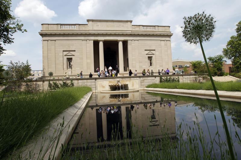 People walk around the renovated gardens and exterior of the Rodin Museum on Wednesday, May 16, 2012, in Philadelphia. After a three-year renovation, the museum is scheduled to reopen to the public on July 13. (AP Photo/Alex Brandon)