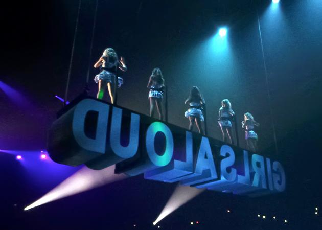 Girls Aloud Ten Tour photos: Girls Aloud stand on top of a floating platform spelling out 'Girls Aloud'. Copyright [WENN]