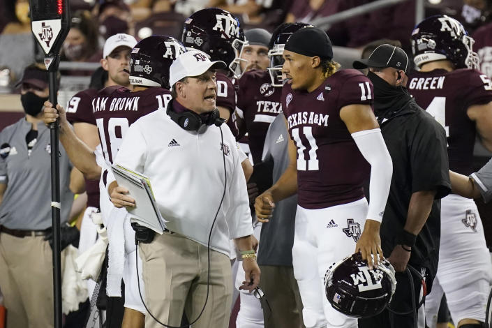 Texas A&M coach Jimbo Fisher, left, talks with quarterback Kellen Mond (11) during the first half of a college football game against Vanderbilt on Sept. 26, 2020. (AP)