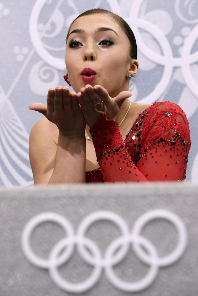 Gabrielle Daleman of Canada blows a kiss to spectators as she waits in the results area after completing her routine in the women's short program figure skating competition at the Iceberg Skating Palace during the 2014 Winter Olympics, Wednesday, Feb. 19, 2014, in Sochi, Russia. (AP Photo/Bernat Armangue)