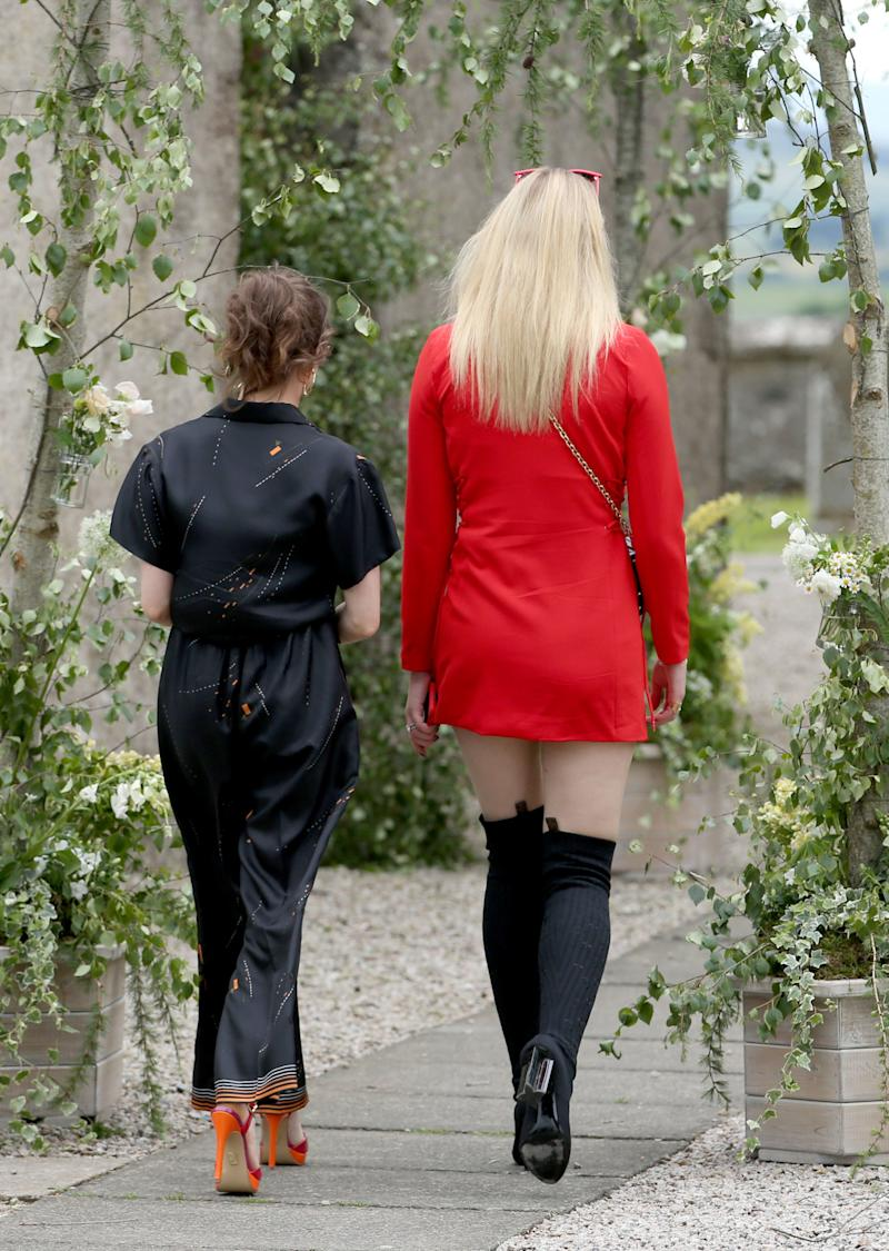 Actress Sophie Turner (right) and Maisie Williams arrive at Rayne Church, Kirkton of Rayne in Aberdeenshire, for the wedding ceremony of Game Of Thrones stars Kit Harington and Rose Leslie. (Photo by Jane Barlow/PA Images via Getty Images)