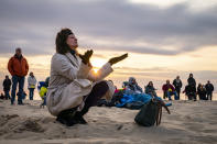 Parishioners gather on a beach for an Easter Sunday service at sunrise hosted by Hope Community Church of Manasquan, Sunday, April 4, 2021, in Manasquan, N.J. (AP Photo/John Minchillo)