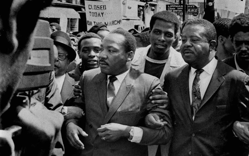Martin Luther King Jr (c) described Jewish landlords in Chicago as showing greater favour towards white tenants - AP/Sam Melhorn