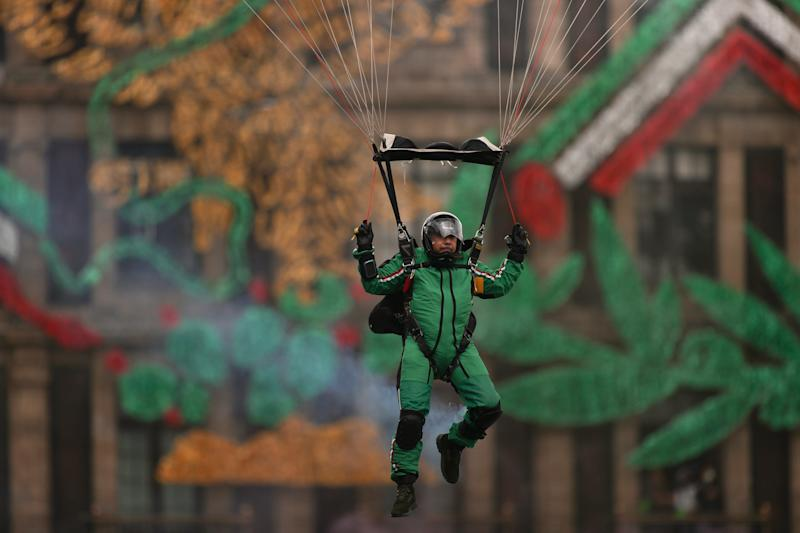 VARIOUS CITIES, MEXICO - SEPTEMBER 16: A Parachuter of the Mexican army takes part in the Independence Day military parade at Zocalo Square on September 16, 2020 in Various Cities, Mexico. This year El Zocalo remains closed for general public due to coronavirus restrictions. Every September 16 Mexico celebrates the beginning of the revolution uprising of 1810. (Photo by Hector Vivas/Getty Images)