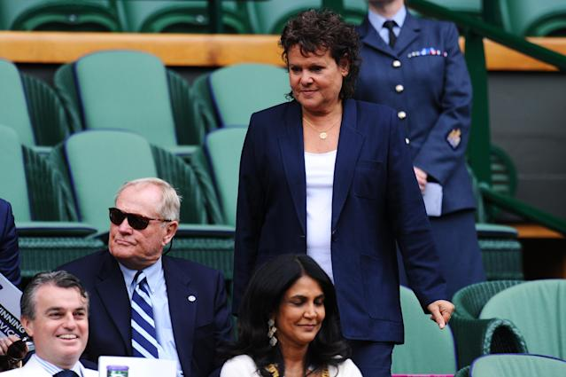 LONDON, ENGLAND - JULY 01: Evonne Goolagong-Cawley walks past Jack Nicklaus as she makes her way to her seat in the Royal Box on Centre Court during day seven of the Wimbledon Lawn Tennis Championships at the All England Lawn Tennis and Croquet Club on July 1, 2013 in London, England. (Photo by Mike Hewitt/Getty Images)