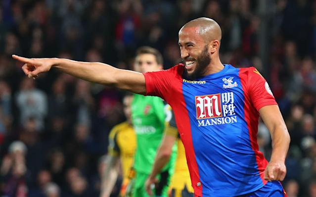 <p>Andros Townsend celebrates making it 1-0</p>