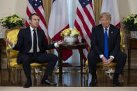 President Donald Trump listens as French President Emmanuel Macron speaks during a meeting at Winfield House during the NATO summit, Tuesday, Dec. 3, 2019, in London. (AP Photo/ Evan Vucci)