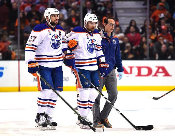 ANAHEIM, CA - MAY 05: Andrej Sekera #2 of the Edmonton Oilers is helped off the ice by Milan Lucic #27 and a trainer during the first period against the Anaheim Ducks in Game Five of the Western Conference Second Round during the 2017 NHL Stanley Cup Playoffs at Honda Center on May 5, 2017 in Anaheim, California. (Photo by Harry How/Getty Images)