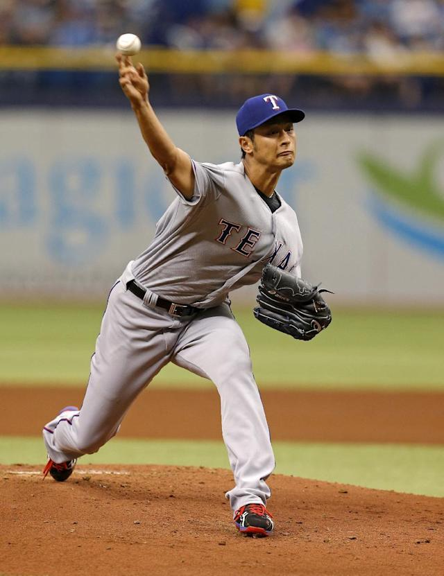Texas Rangers starting pitcher Yu Darvish throws during the first inning of a baseball game against the Tampa Bay Rays, Sunday, April 6, 2014, in St. Petersburg, Fla. (AP Photo/Mike Carlson)
