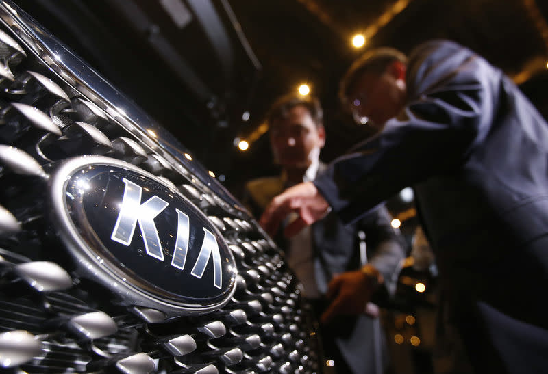 Visitors looks at Kia Motors' new Sorento SUV at its launch event in Seoul