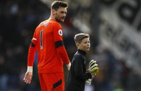 Britain Soccer Football - Manchester United v West Bromwich Albion - Premier League - Old Trafford - 1/4/17 Tottenham's Hugo Lloris and a child celebrate after the match Action Images via Reuters / Lee Smith Livepic