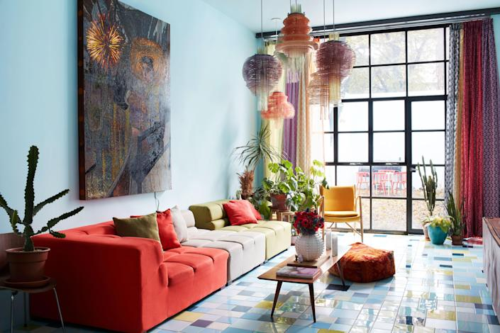 For the main living space of his home in Bushwick, Brooklyn, artist Jorge Pardo conceived signature lamps and splashes of tilework; the painting is also by Pardo.