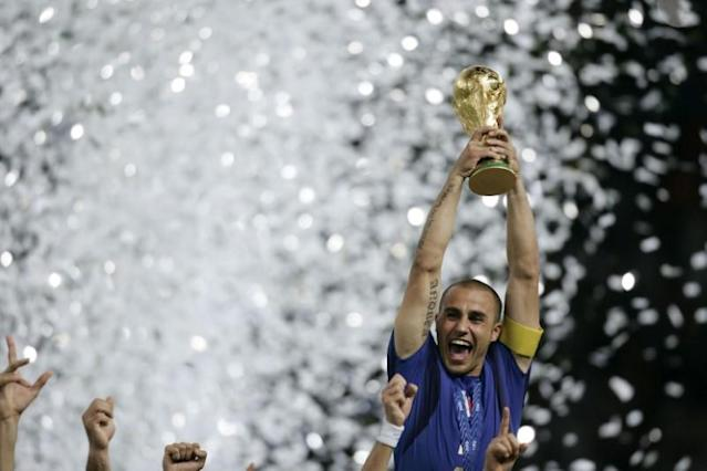 FILE PHOTO: Italy's Fabio Cannavaro lifts the World Cup Trophy after the World Cup 2006 final soccer match betwe..