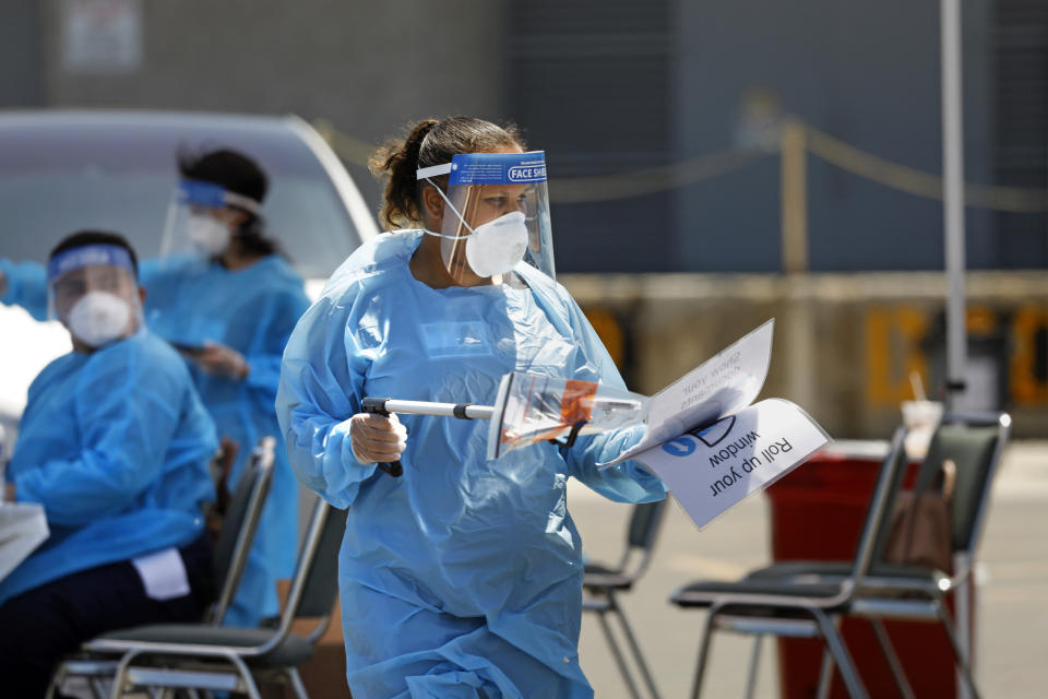 An Orange County testing site at the Anaheim Convention Center. Clinicians from 360 Clinic are administering the test kits, but citizens will do their own sample taking. (Carolyn Cole/Los Angeles Times)