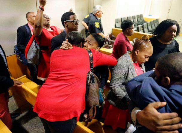 PHOTO: Members of Botham Jean's family embrace in the courtroom after fired Dallas police Officer Amber Guyger was found guilty of murder, Oct. 1, 2019, in Dallas. (Tom Fox/The Dallas Morning News via AP, Pool)