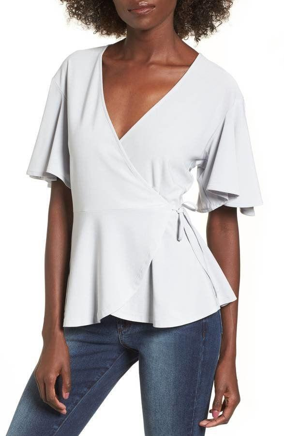 """Get it <a href=""""https://shop.nordstrom.com/s/leith-flounce-sleeve-faux-wrap-top/4740030?origin=category-personalizedsort&amp;fashioncolor=BLUE%20PEARL"""" target=""""_blank"""">here</a>.&nbsp;"""