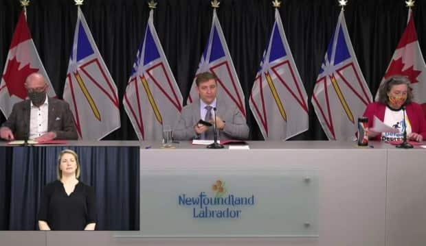From left, Health Minister John Haggie, Premier Andrew Furey and Chief Medical Officer of Health Dr. Janice Fitzgerald prepare for Wednesday's COVID-19 briefing. The government has announced that each reporter will be allowed to ask fewer questions at future briefings.