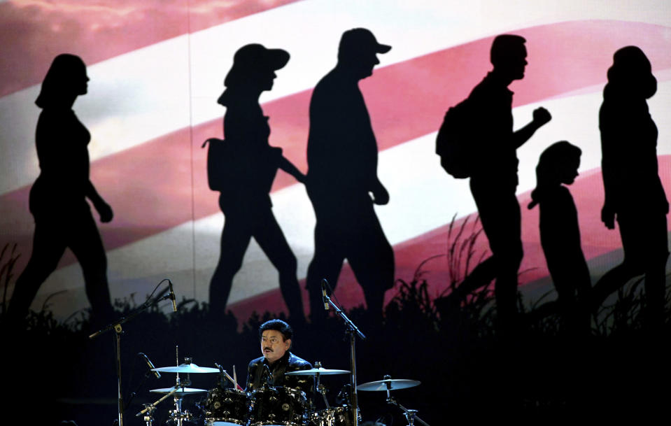 Oscar Lara, drummer for Los Tigres del Norte performs for the 21st Latin Grammy Awards, airing on Thursday, Nov. 19, 2020, at American Airlines Arena in Miami. (AP Photo/Taimy Alvarez)
