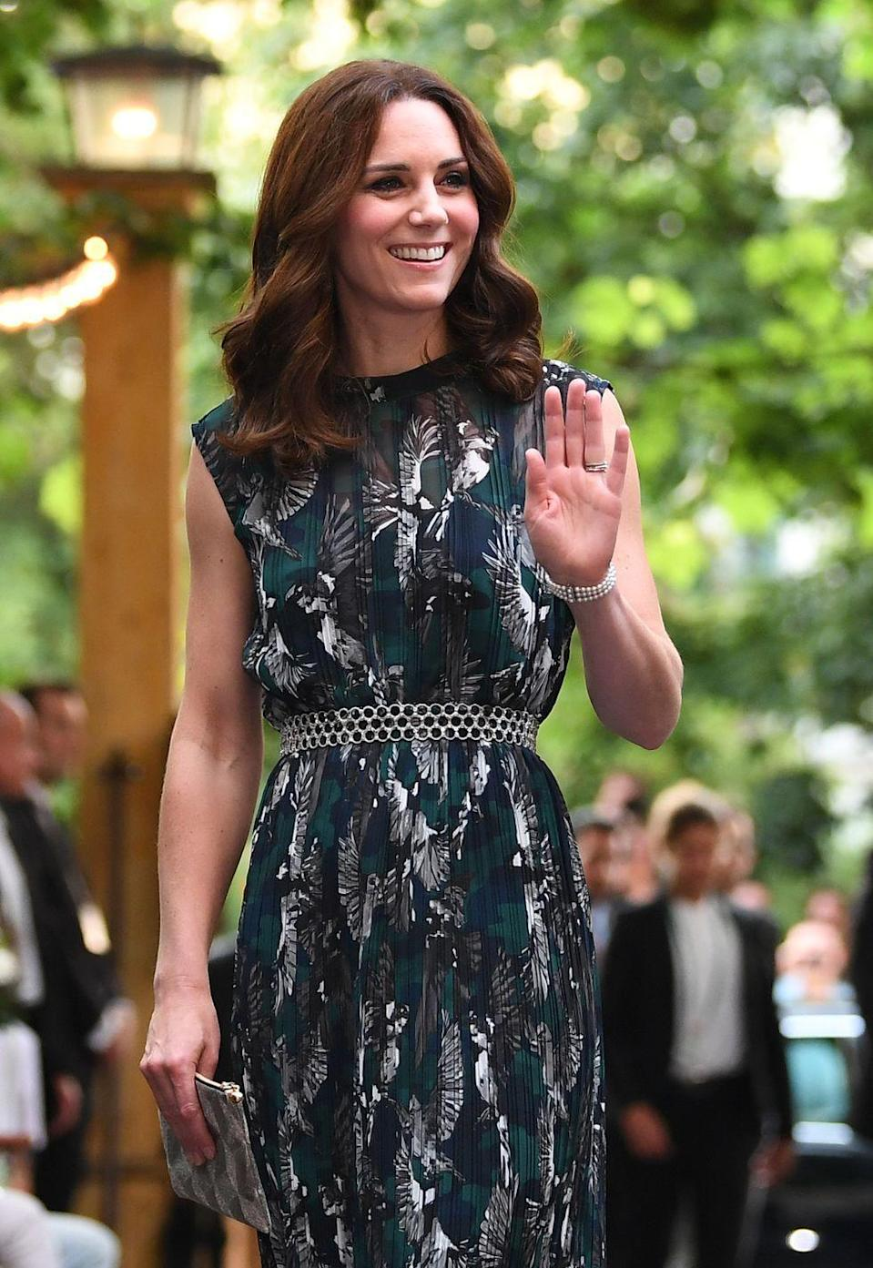 """<p><em>Marie Claire UK</em> says <a href=""""https://www.marieclaire.co.uk/news/fashion-news/hidden-detail-kate-middleton-berlin-dress-524709#LLhhfaMlj6qsTjha.99"""" rel=""""nofollow noopener"""" target=""""_blank"""" data-ylk=""""slk:the same goes for the striking eagles in flight dress"""" class=""""link rapid-noclick-resp"""">the same goes for the striking eagles in flight dress</a> that Kate wore her last night in Germany in 2017, where eagles are the national bird. The dress also was created by a German designer. </p>"""